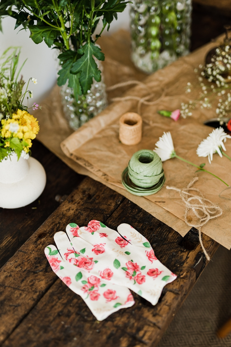 florist gloves on table with bouquets and twine 4466296